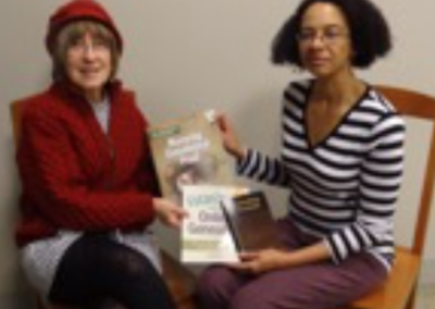 Daughters donate books to the Evanston Public Library.